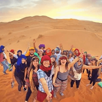 tourists doing camel trekking and having fun during their vacation adventures in Marrakech